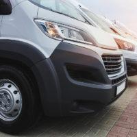Business vehicles or vans parked alongside