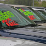 Buyback cars with price on windshield in lot