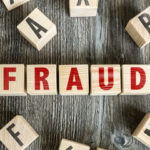 Blocks that spell out fraud to highlight how common auto dealer fraud is