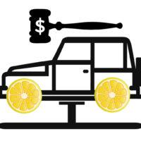 Lemon law concept - Lemon wheels on car with gavel on top