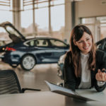 Woman talking to car manufacturer or dealer