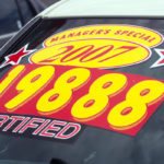 Price sticker on certified used car