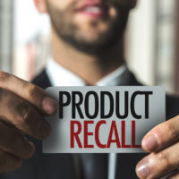 product recall caption held by businessman