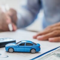 Sale agent deal to agreement successful car loan contract with customer and sign agreement contract Insurance car concept.