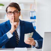 Businessman receiving his salary and bonus