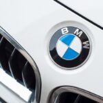 Mulhouse - France - 3 April 2018 - closeup of BMW Logo on white car, BMW is a german brand multinational company which currently produces automotive